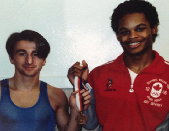 Florent Poirier with Raymond Downey of Halifax, NS who captured bronze medal at the 1988 Seoul Olympic Games.